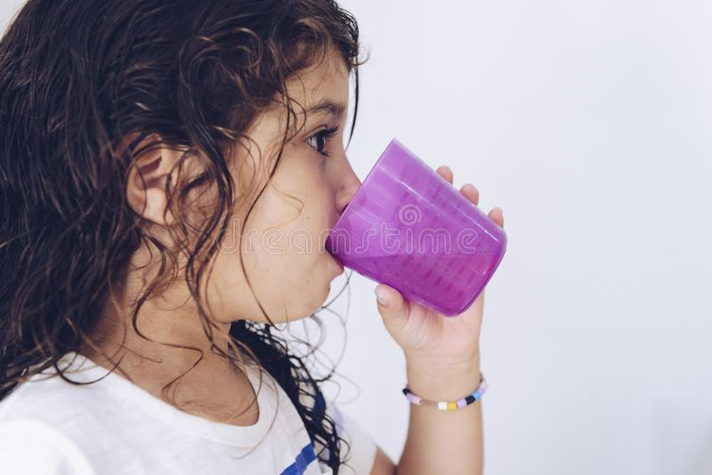 Little girl rinsing her mouth after brushing teeth stock image