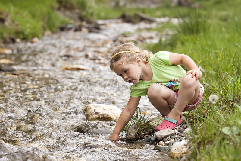 Little girl at the river stock photos