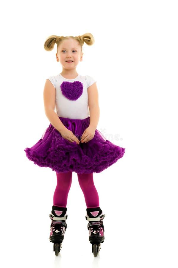 Little girl on roller skates. royalty free stock photos