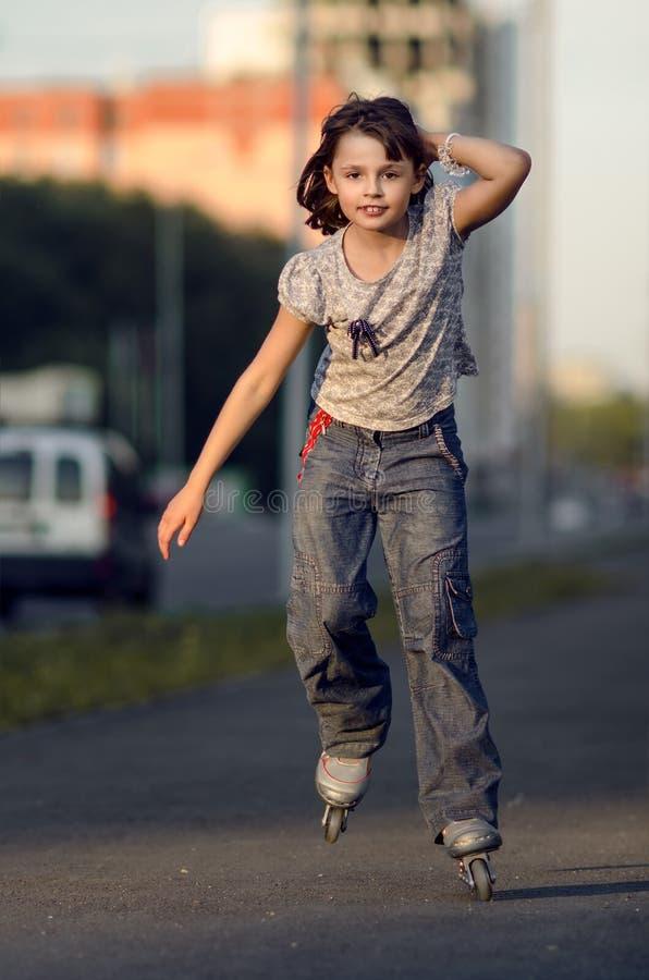 Little girl on roller skates stock image