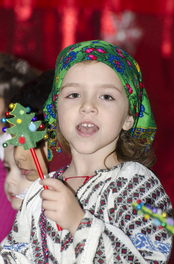 Little girl in Romanian national costume. A small girl in Romanian national costume singing during a Kindergarten Christmas festivity stock images