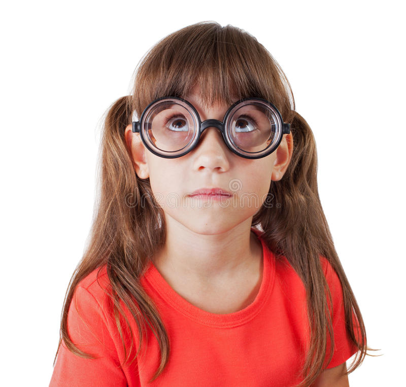 Little girl in round glasses. Looking up stock photography
