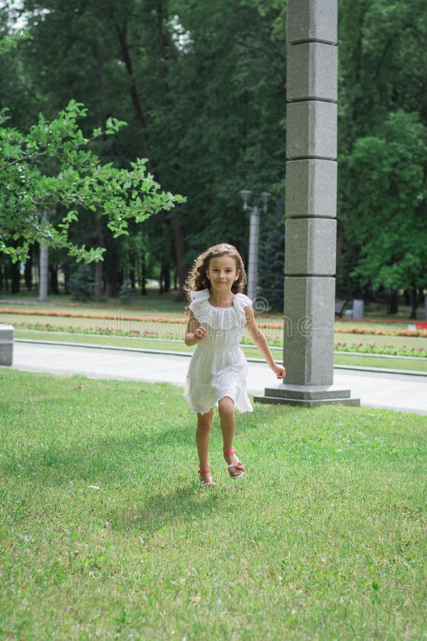 Little girl run in autumn or summer park. Happy child royalty free stock images