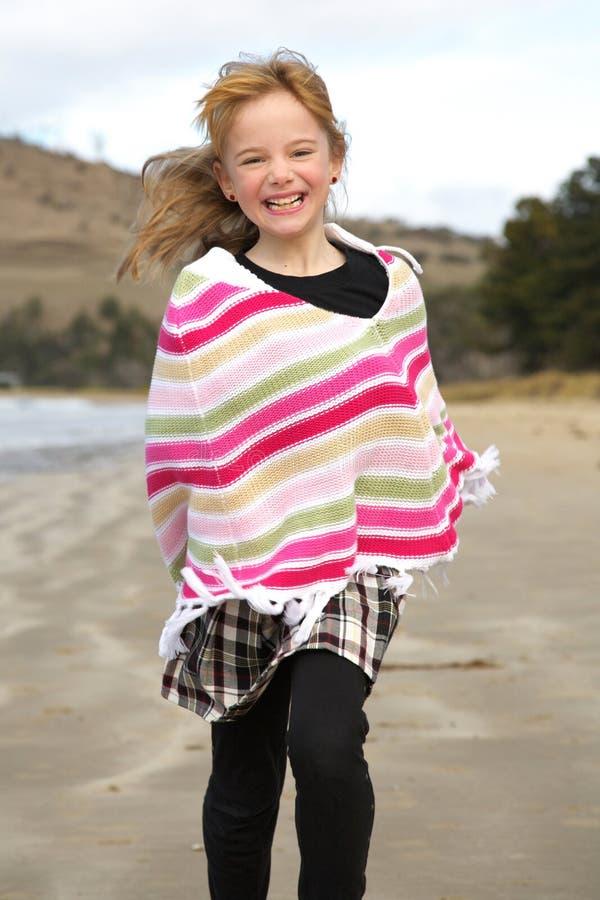 Little girl running. A little girl running on the beach stock photos