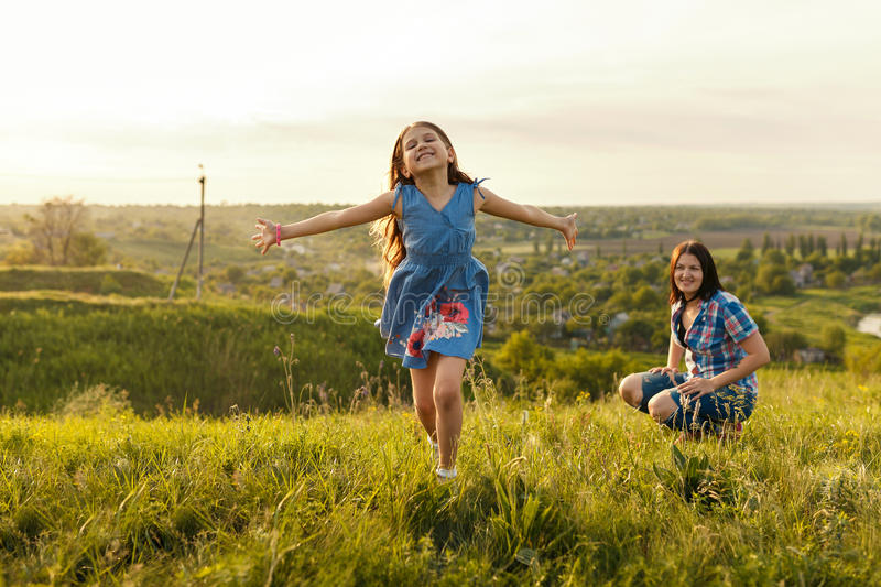 Little girl running on meadow stock images