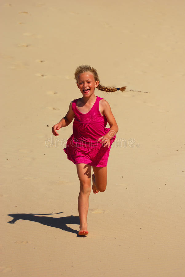 Download Little Girl Running In Sand Stock Image - Image: 18357793
