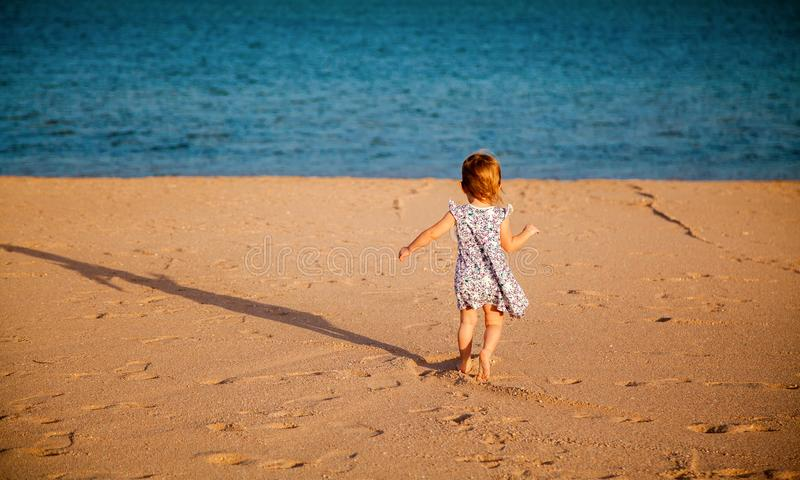 Girl running to the sea royalty free stock photography