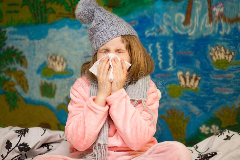Little girl with runny nose wipes her nose. Health concept royalty free stock photos