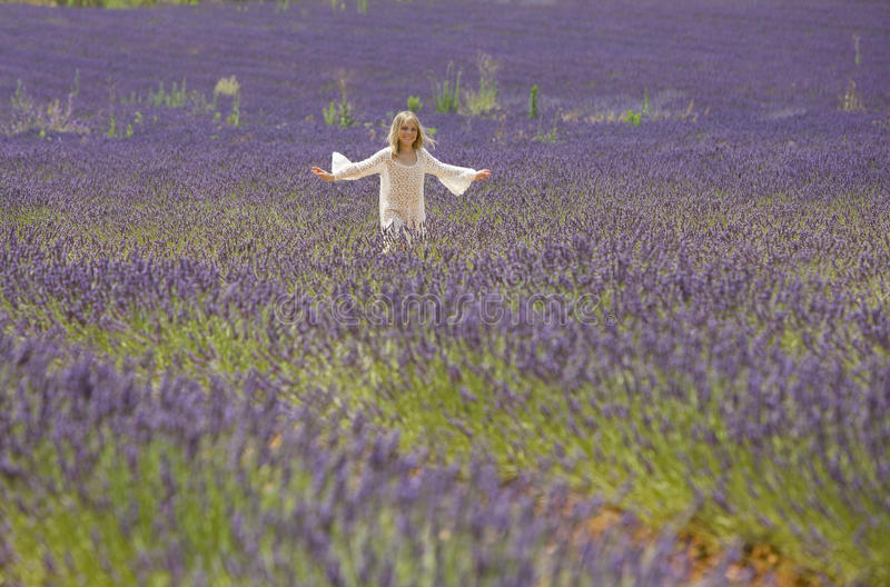 Little girl runs in lavender field royalty free stock image