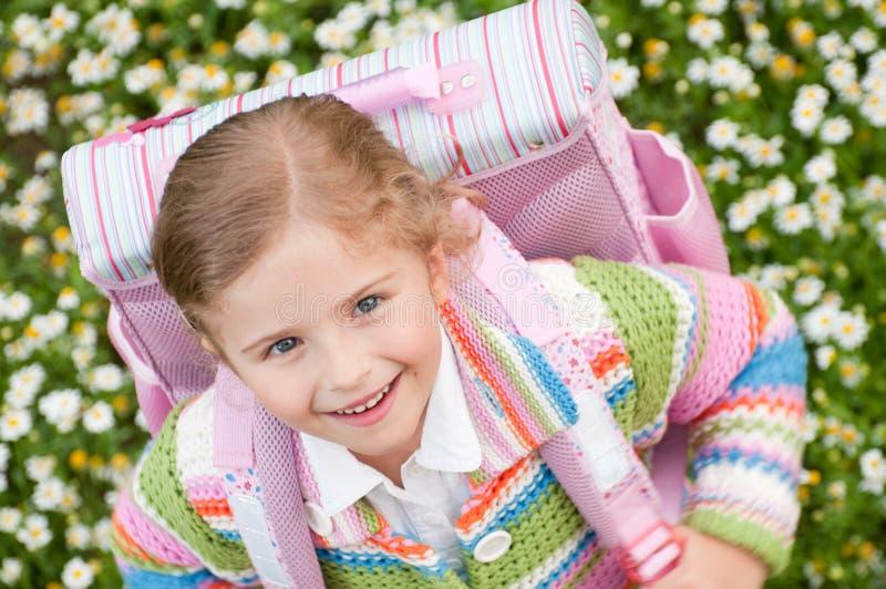 Little girl rushing to school stock photo