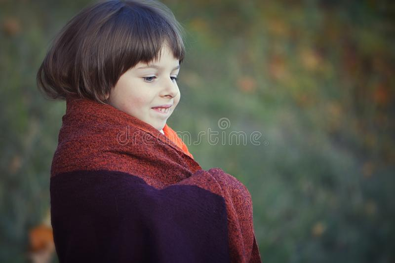 Little girl`s portrait in red shawl royalty free stock photography