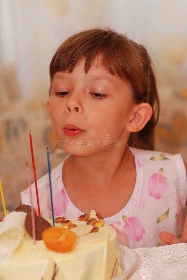 Little girl's birthday. Little girl with birthday cake royalty free stock photos
