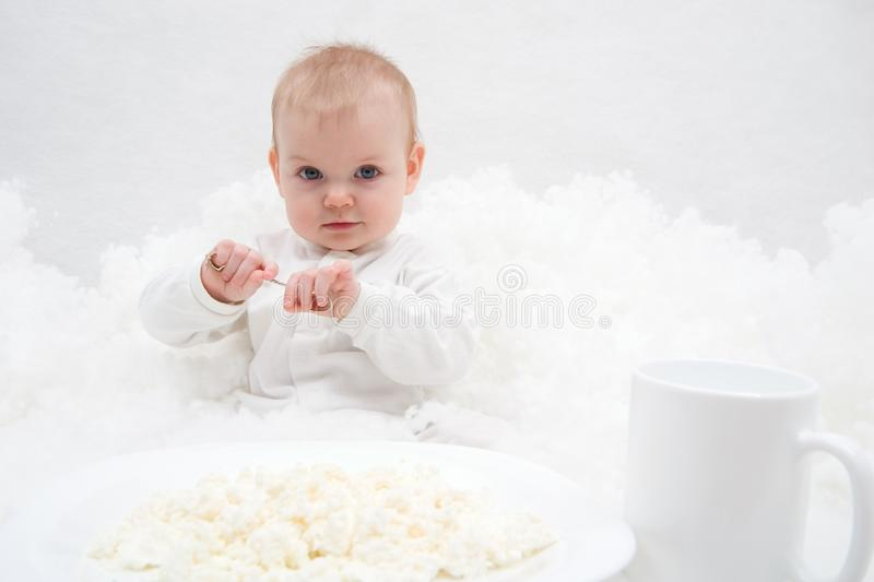Little girl's breakfast royalty free stock image