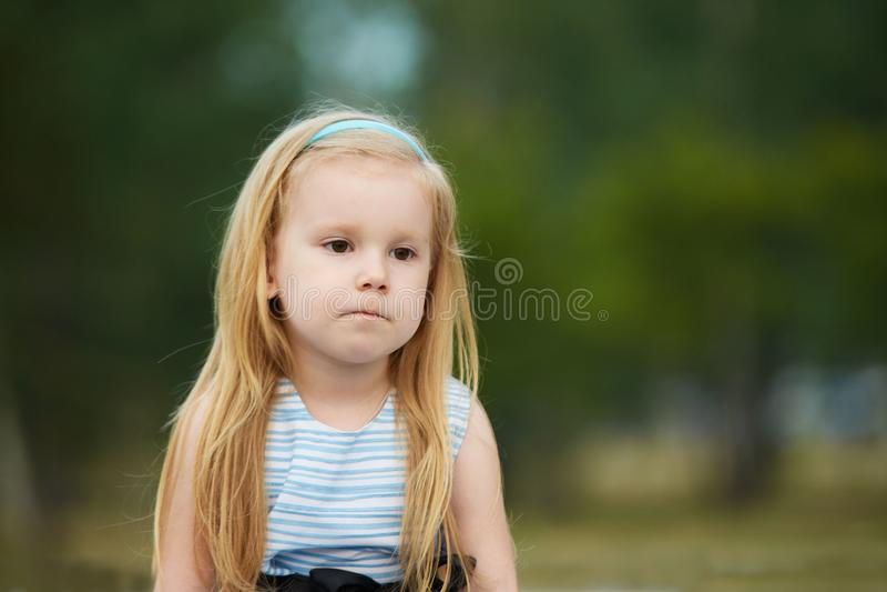Sadness. Thoughtfulness. Little girl. Portrait child. Blonde royalty free stock photography