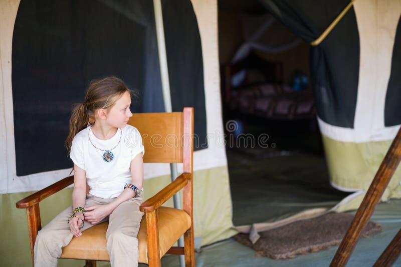 Little girl on safari. Little girl in safari tent enjoying luxury vacation in Africa royalty free stock image