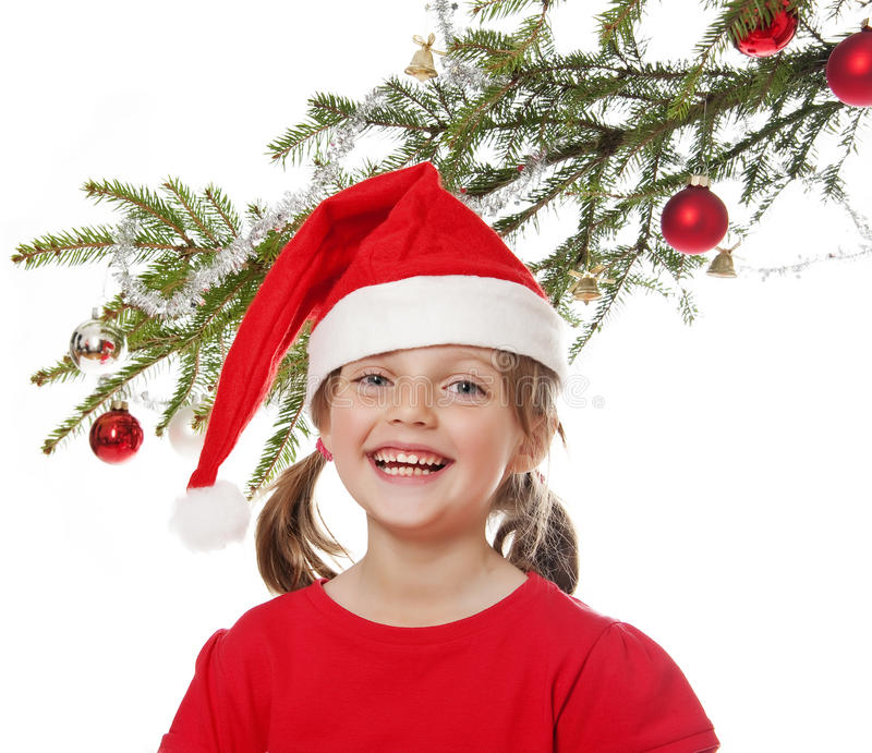 Download Little Girl With Santa Cap And Christmas Tree Royalty Free Stock Photography - Image: 26719297