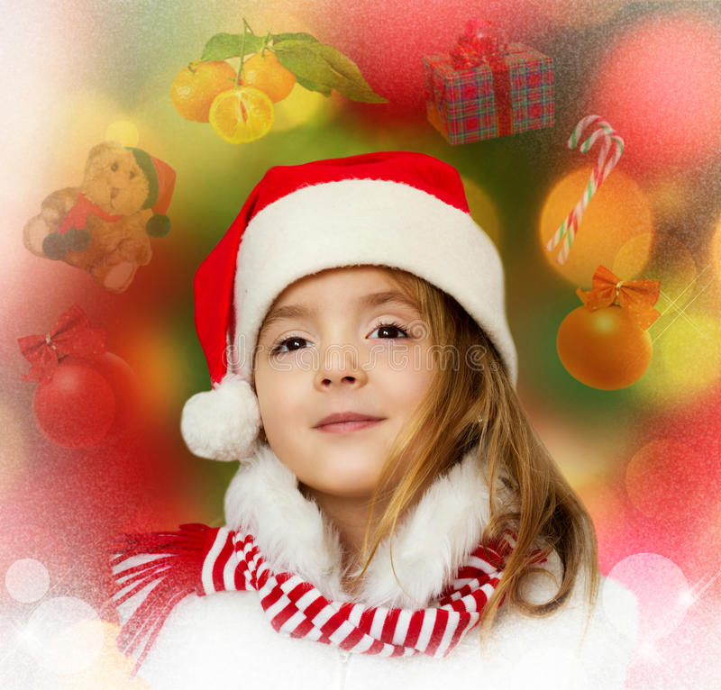 Little girl in santa clothes dreaming about christmas, new year. royalty free stock photography