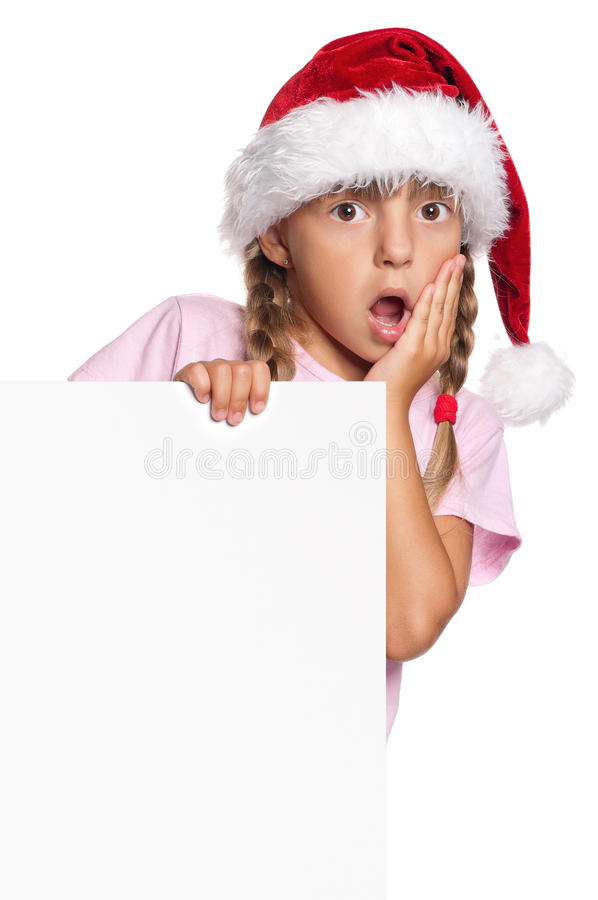 Little girl in Santa hat. Portrait of little girl in Santa hat with white blank royalty free stock images