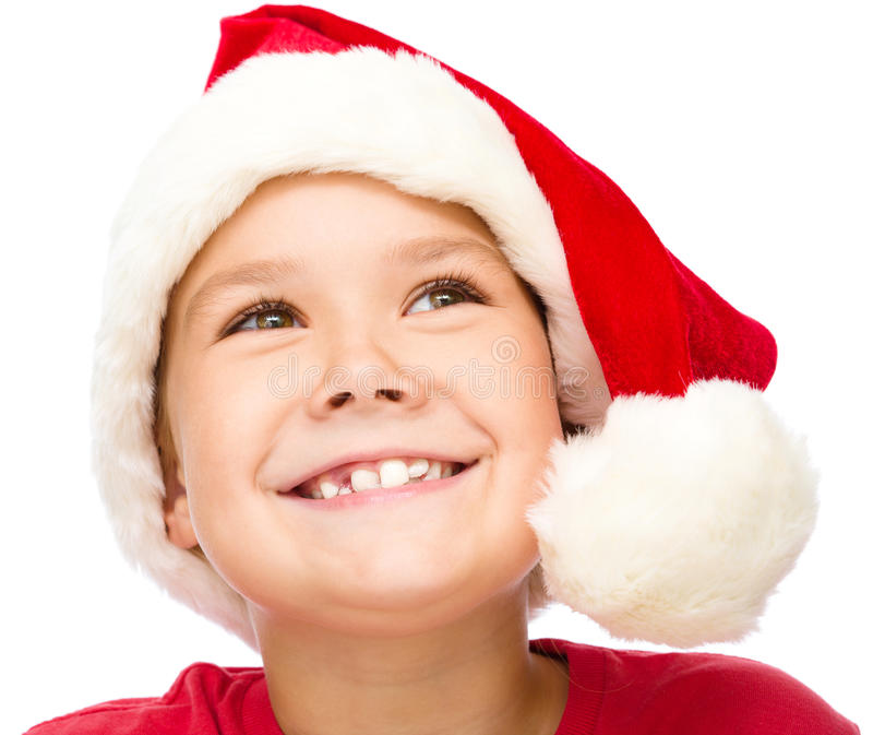 Little girl in santa hat is daydreaming. Isolated over white royalty free stock photos