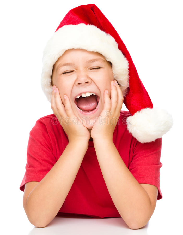 Little girl in santa hat is daydreaming. Supporting her head with hands and closed eyes, isolated over white royalty free stock photos