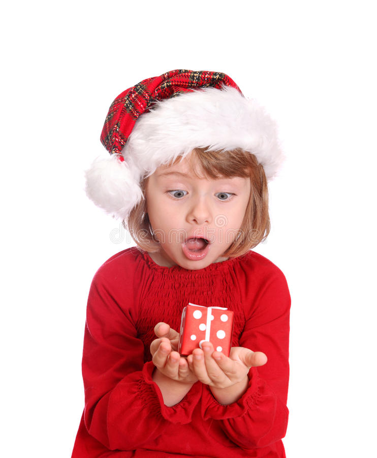 Little girl with santa hat and red gift box stock images