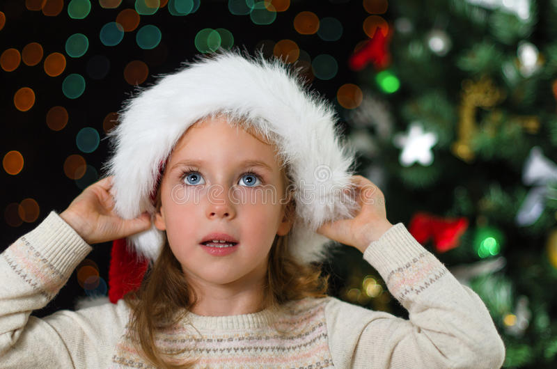 Download Little girl in santa's hat stock photo. Image of bokeh - 34655326