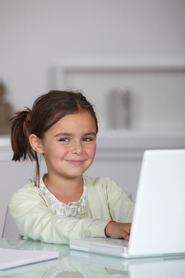 Little Girl Sat With Laptop Royalty Free Stock Photography