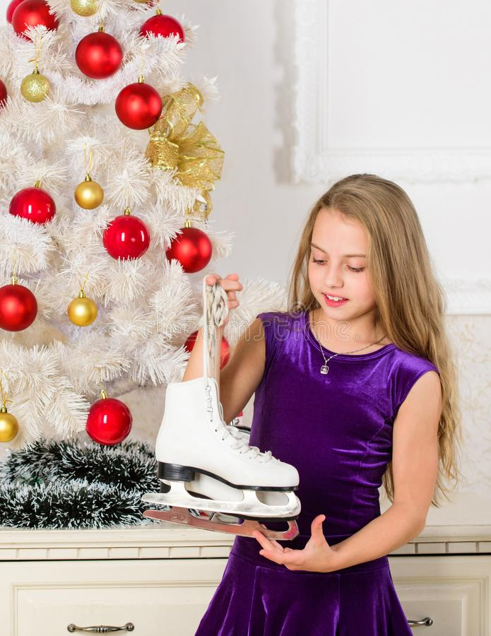 Little girl satisfied christmas gift. Best gift ever. Happy new year concept. Dreams come true. Got gift exactly she. Wanted. Figure skating concept. Kid near stock photos