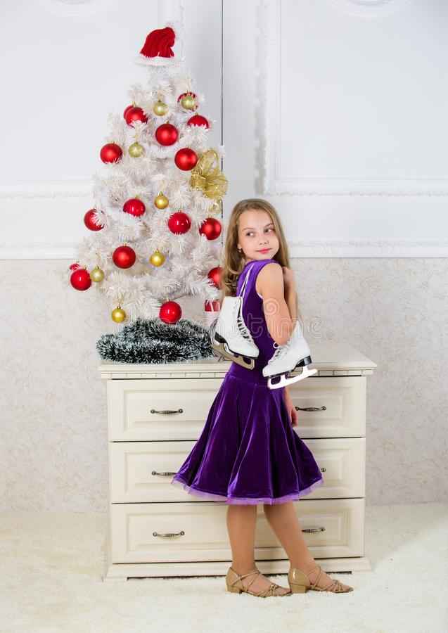 Little girl satisfied christmas gift. Best gift ever. Happy new year concept. Got gift exactly she wanted. Figure. Skating concept. Dreams come true. Kid near royalty free stock photo