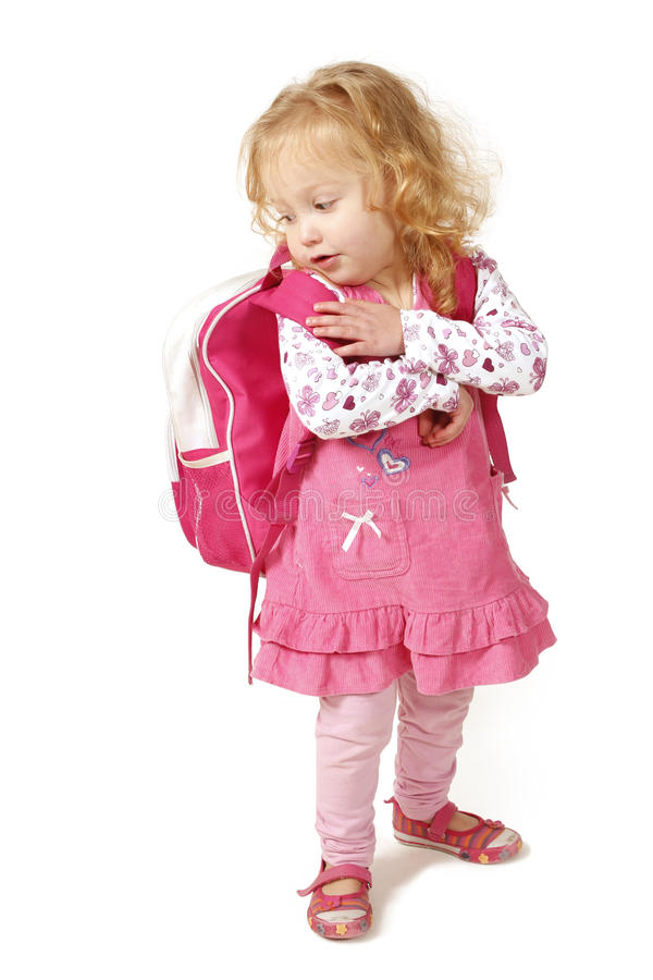 Little girl with school bag stock images