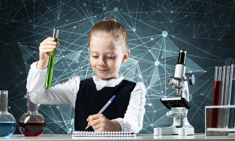 Little girl scientist examining test tube royalty free stock images