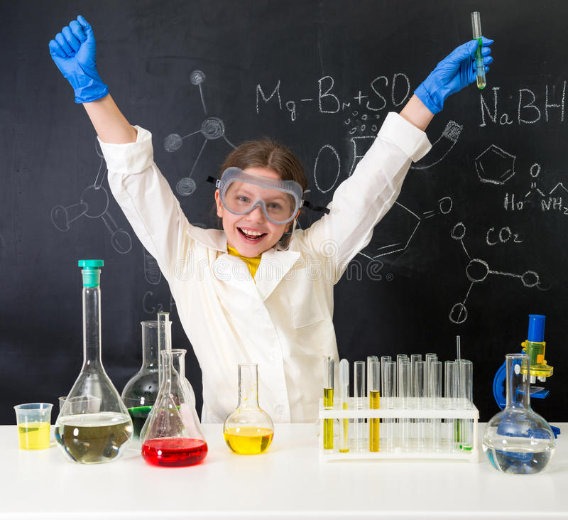 Little girl-scientist happy with a chemnical experiment royalty free stock photography