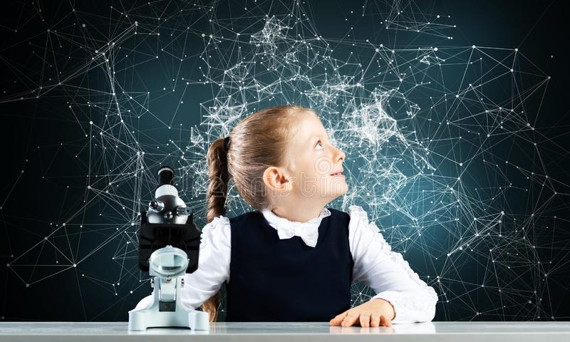 Little girl scientist with microscope royalty free stock photography