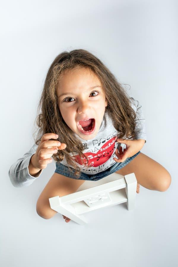 Little girl screaming framed from above stock photo