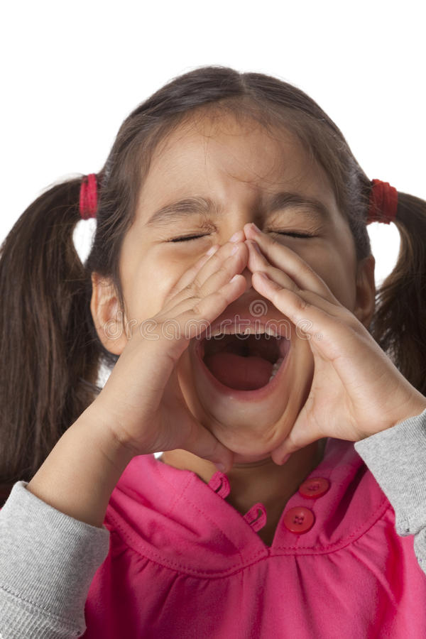 Little girl is screaming with her fingers around. Her mouth on white background royalty free stock photos