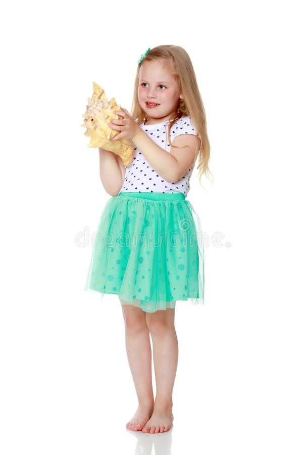 Little girl with sea shell royalty free stock photography