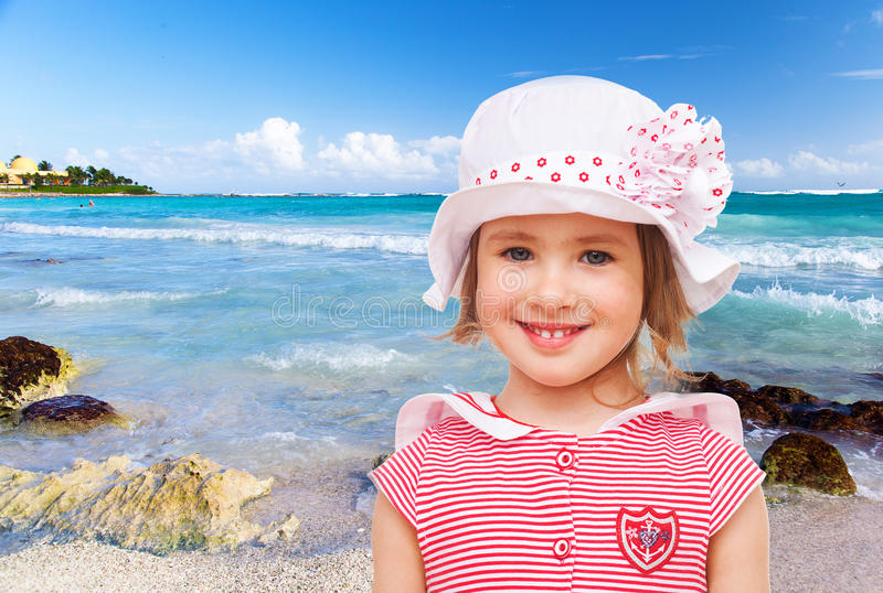 Little girl in a sea suit stock image