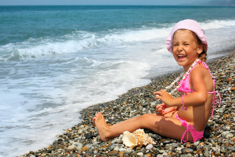 Download Little Girl With Seashell And Necklace On Seacoast Stock Image - Image: 11720403