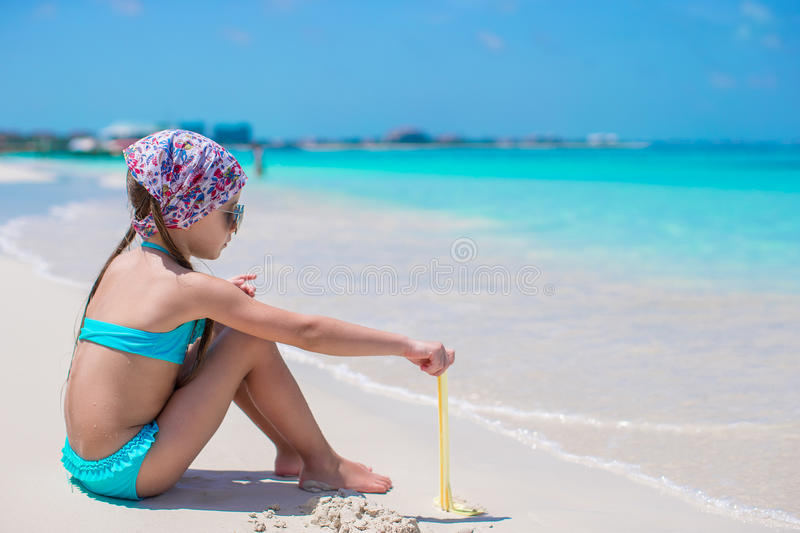 Little girl on seashore during summer vacation royalty free stock images