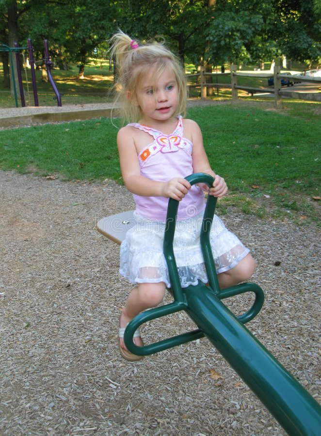 Download Little Girl On See-Saw stock photo. Image of rides, ride - 3289590