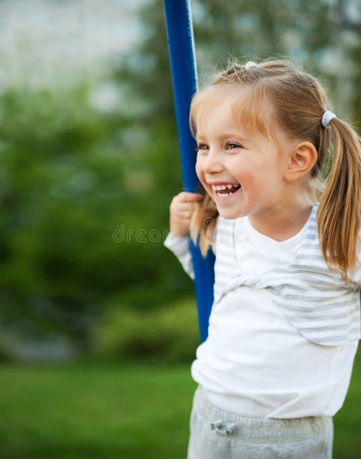 Little girl on seesaw stock images