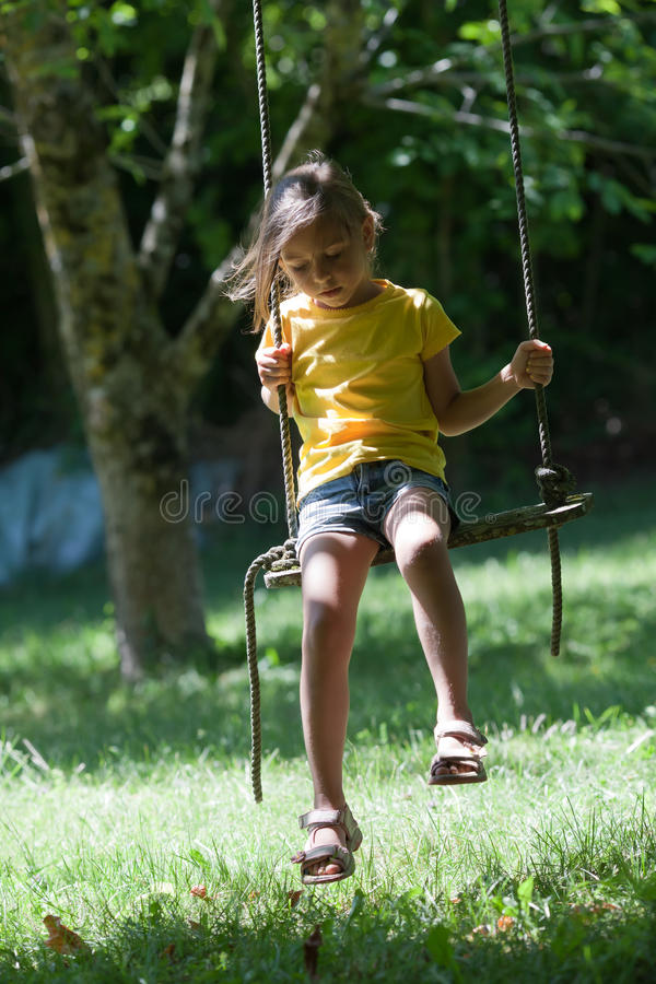 Little girl on seesaw stock images
