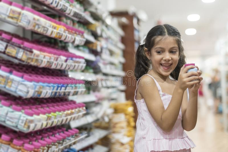 Little girl selecting paints for her school homework royalty free stock photos