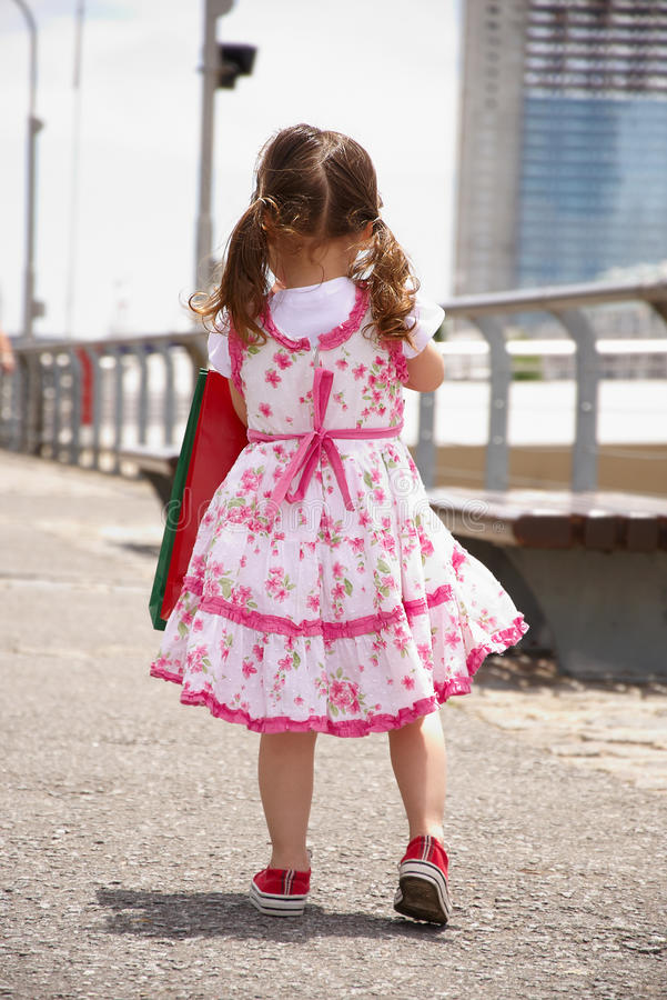 Download Little Girl With Shopping Bags Stock Image - Image: 12700111