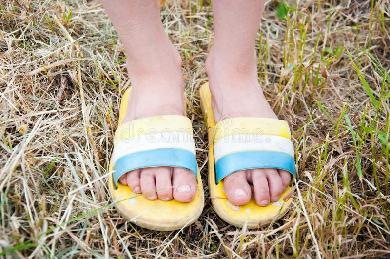 Little girl in shorts and flip-flops standing royalty free stock photography