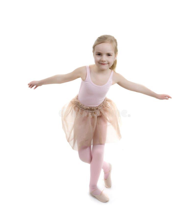 Little girl showing ballet exercises stock image