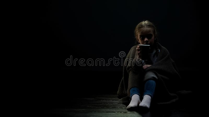 Little girl showing beggar cup, asking for donation, charity, homeless children stock images