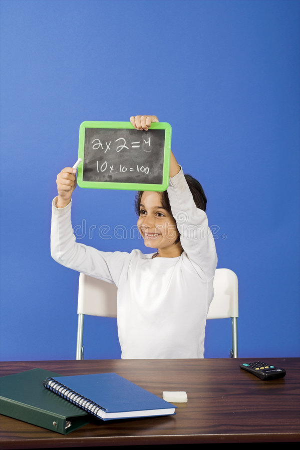 Little girl showing chalkboard stock photos