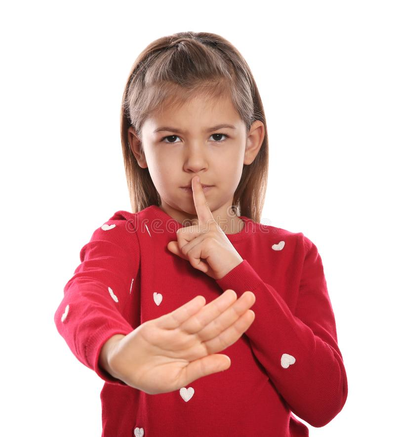Little girl showing HUSH gesture in sign language on white royalty free stock photography