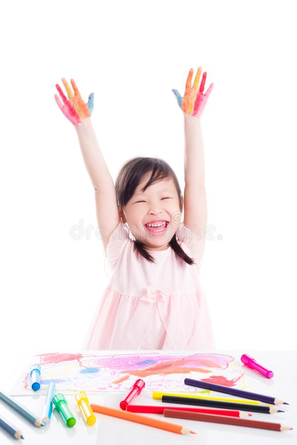 Little girl showing painted hand over white backgrou stock photo